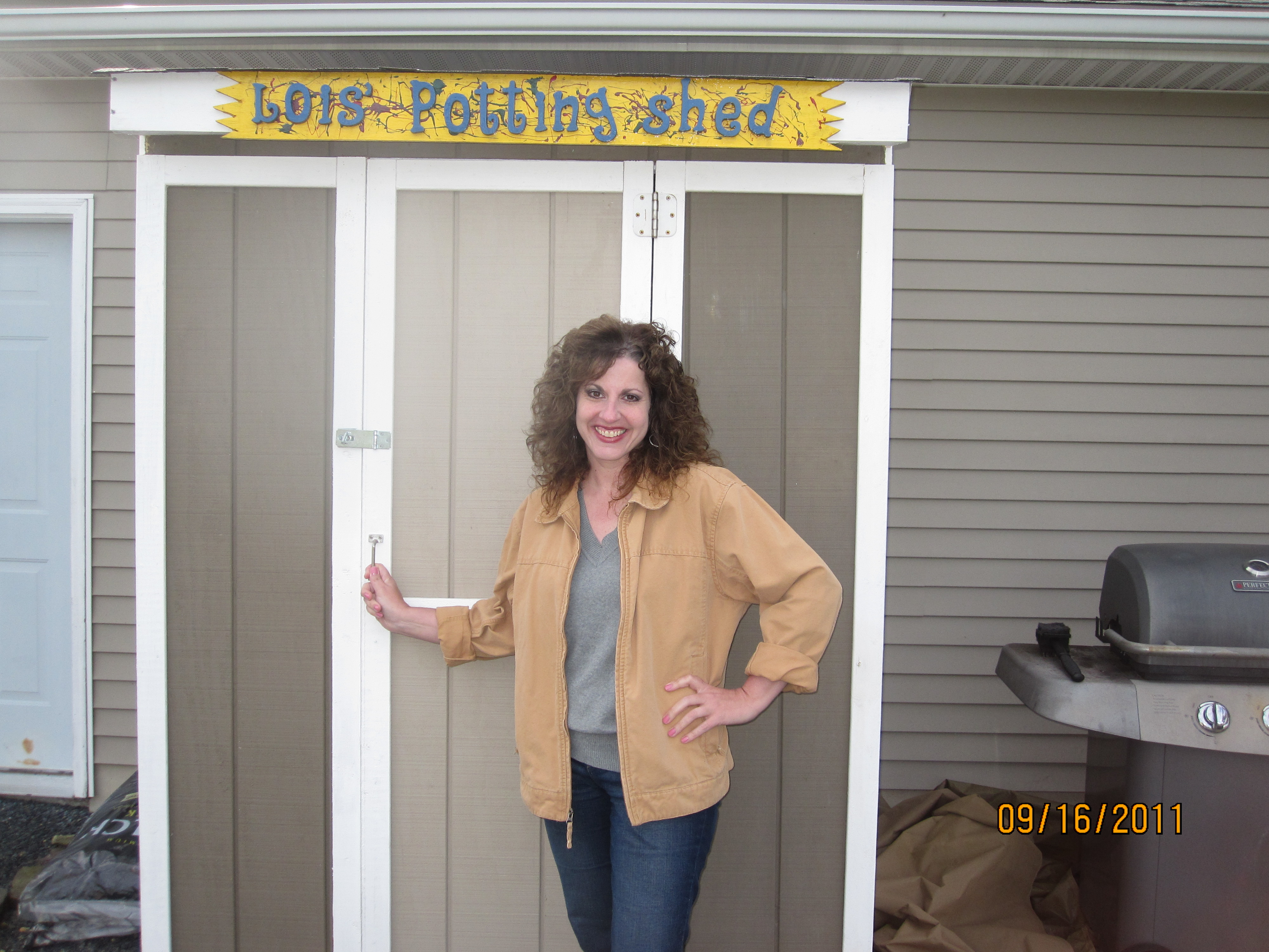 Lois Christensen, cooking blogger and mother of two standing in front of a much different shed than the one mentioned in this post.  Before the author figured out how to take digital pictures without timestamps.